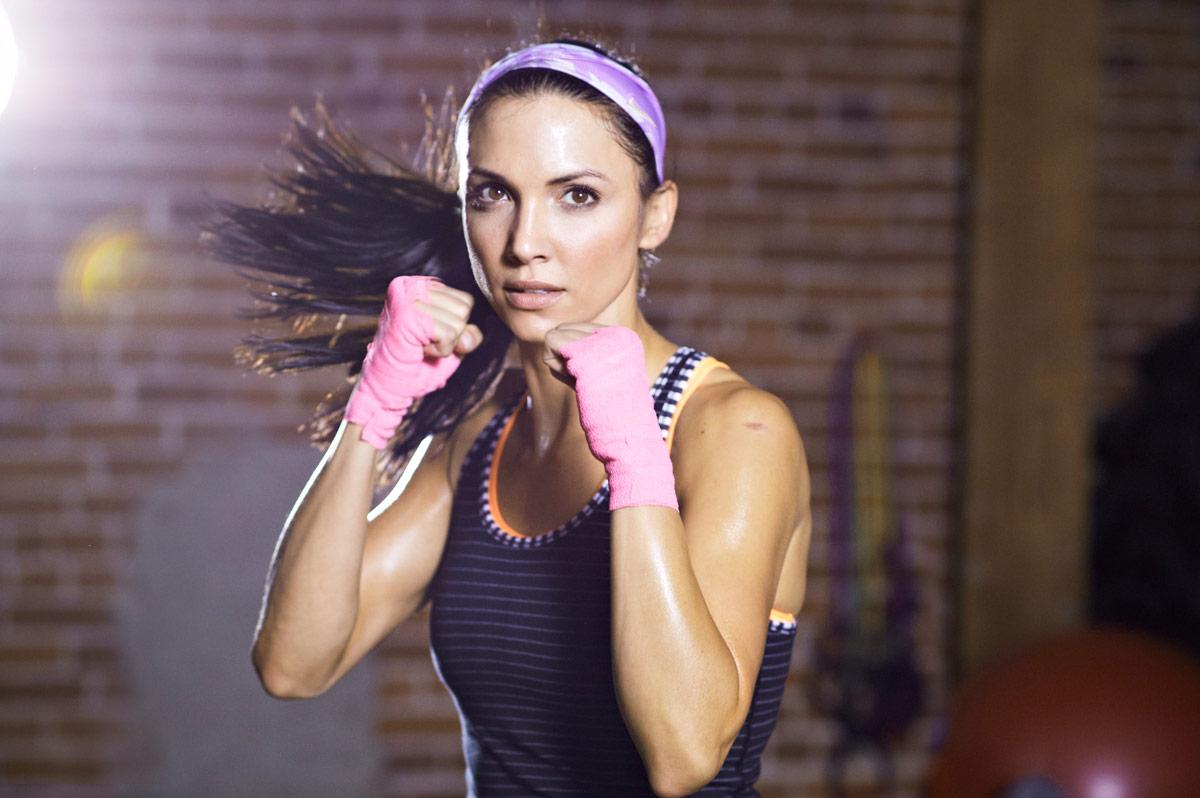 A female athlete training inside a gym.